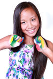 Happy asian girl. With painted hands Royalty Free Stock Images