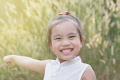 Happy Asian girl child raising hands with happiness Stock Photos