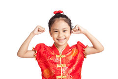 Happy Asian girl in chinese cheongsam dress flex bicep Royalty Free Stock Photos