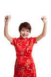 Happy Asian girl in chinese cheongsam dress. royalty free stock photo