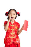 Happy asian girl in chinese cheongsam dress with red envelope Royalty Free Stock Image