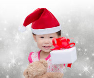 Happy asian girl with christmas hat Stock Photos