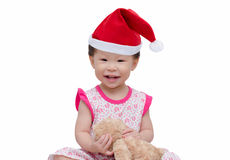 Happy asian girl with christmas hat Royalty Free Stock Photos