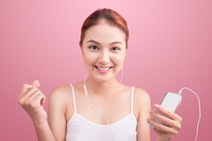 Happy asian girl dancing and listening to the music  on Stock Images