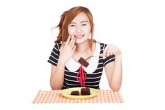 Happy Asian girl eat brownie. Isolated on white background Stock Images
