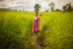 Happy Asian girl enjoy in green rice field, countryside of Thail Stock Photography