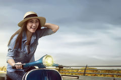 Happy asian girl enjoying traveling by scooter Royalty Free Stock Images