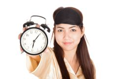 Happy Asian girl with eye mask  show alarm clock Stock Photo