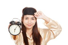 Happy Asian girl with eye mask  show alarm clock Royalty Free Stock Image