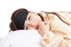 Happy Asian girl with eye mask wake up and smile Stock Photography