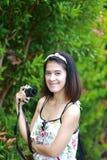 Happy asian girl in garden Stock Photos