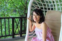 Happy asian girl in garden Stock Images