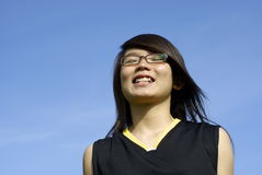 Happy asian girl grinning Royalty Free Stock Images