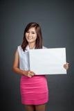 Happy Asian girl hold blank sign Stock Photos