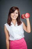 Happy Asian girl hold a dumbbell and smile Royalty Free Stock Photography