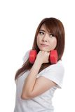 Happy Asian girl hold dumbbell to her chin Royalty Free Stock Image