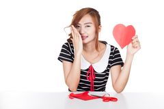 Happy Asian girl hold heart shape paper Stock Images