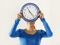Happy asian girl holding big blue clock royalty free stock photos