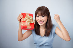 Happy Asian Girl Holding Gift Box Royalty Free Stock Images