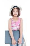 Happy asian girl holding laptop. On white background Stock Image