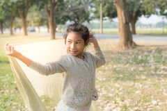 Happy Asian girl holding Scarf in the park outdoor Stock Image