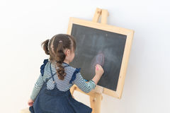 Happy asian girl kid draw cartoon with chalk on blackboard Stock Images