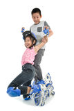 Happy Asian girl learning roller skates Stock Photography