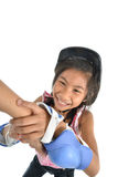 Happy Asian girl learning roller skates on white. Background Royalty Free Stock Images