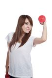 Happy Asian girl lift a dumbbell with confidence Royalty Free Stock Photography