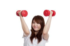 Happy Asian girl lift dumbbells over her head Stock Images