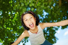 Happy asian girl opens mouth with enthusiasm. Laughing and has fun royalty free stock photography