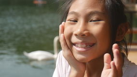 Happy Asian girl outdoor stock video