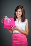 Happy Asian girl with a pink gift box Stock Photos