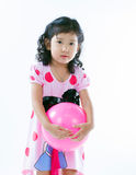 Happy asian girl playing ball Royalty Free Stock Photos