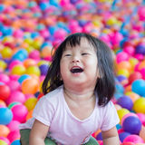Happy Asian girl. Playing with balls Stock Photography