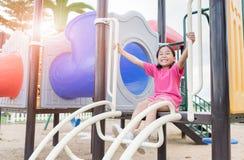 Happy asian girl playing on children playground Stock Photo