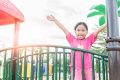Happy asian girl playing on children playground Royalty Free Stock Photo