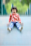 Happy Asian girl playing at playground Royalty Free Stock Images