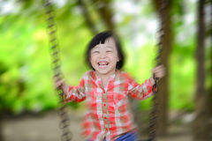 Happy Asian girl playing at playground Stock Photos