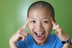 Happy asian girl point at bald head Stock Photos