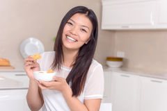 Happy Asian girl posing with food Royalty Free Stock Photography