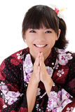 Happy Asian girl praying. And smiling with traditional japanese clothes Stock Photo