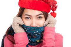Happy Asian girl with red christmas hat and scarf feel cold Stock Photos