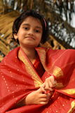 Happy Asian girl in red sari stock photos