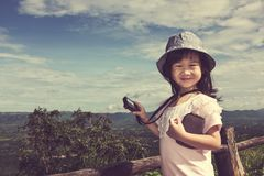 Happy asian girl relaxing outdoors in the daytime, travel on vac Stock Photo