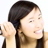 Happy asian girl shaving head Royalty Free Stock Photo