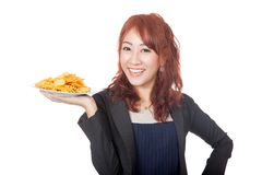 Happy Asian girl smile with a dish of potato chips Stock Image