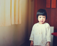Happy Asian girl stading near window at home. Stock Photo