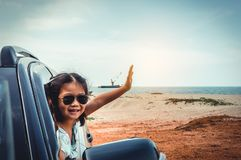 Asian girl smiling while sitting in the car. Travel on vacation royalty free stock photography