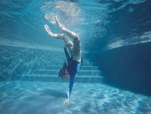 Happy asian girl swim and dive underwater, summer family vacation with child,relax,fun activity royalty free stock photos